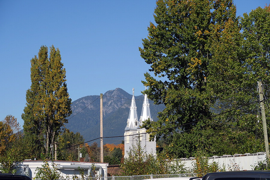 Silver steeples against mountain backdrop