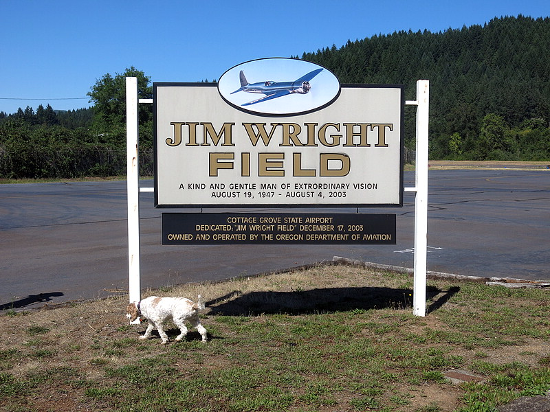 Zeus checking out Jim Wright Airfield sign