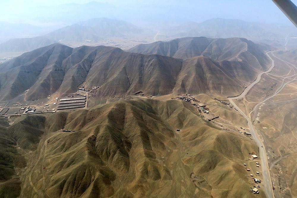 Desolate, dry mountains surrounding Lima