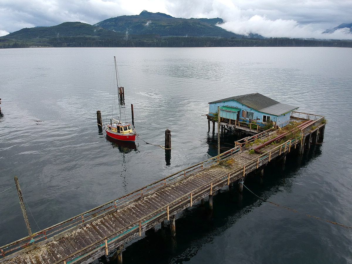 Aerial of red fishing boat, Alert Bay